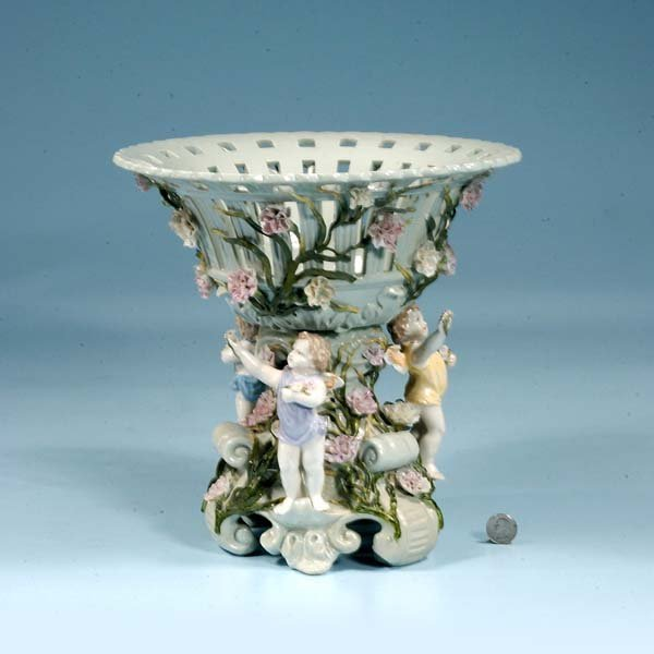 24: Continental porcelain centerpiece with cherub and f