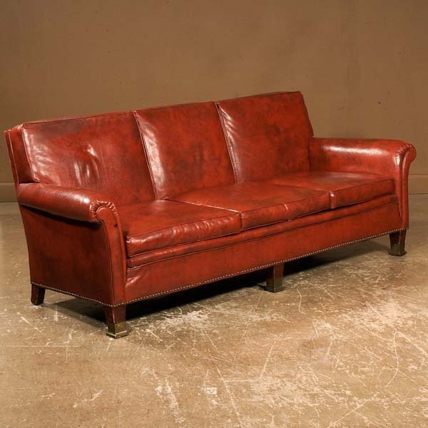 625: Leather roll over arm sofa on straight Chippendale