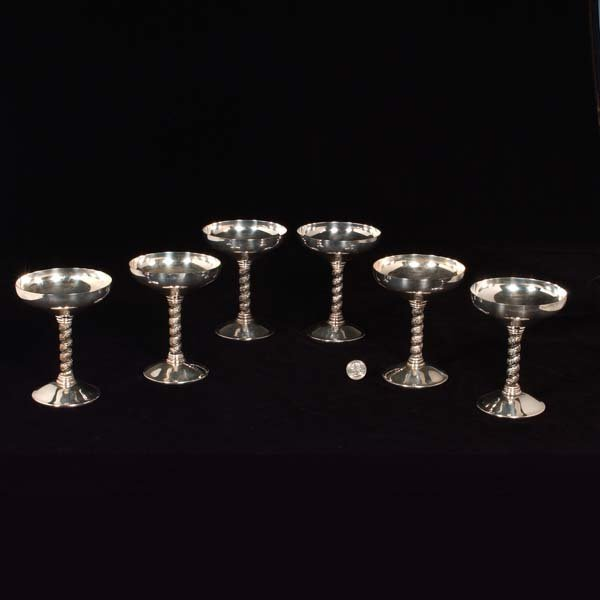 429: Set of six silver plated champagne glasses