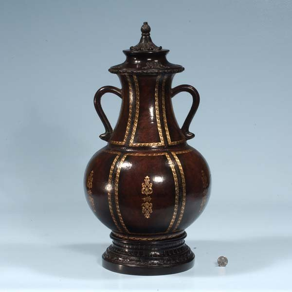 431: Leather bound dome top urn with gold gilt decorati