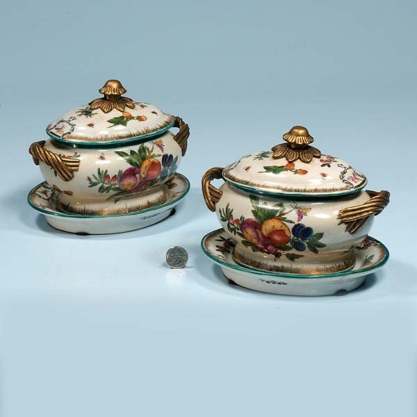 434: Pair of oval porcelain sauce tureens and under pla