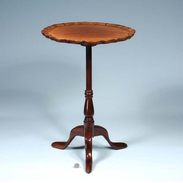 437: English mahogany tripod candle stand with scallope