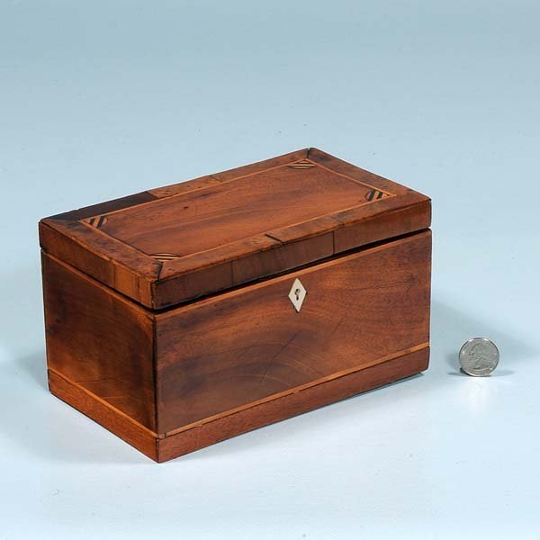 439: Inlaid Sheraton mahogany tea caddy with fitted int