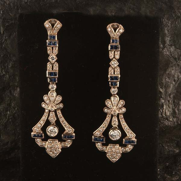 445: Pair of 18 kt. white gold chandelier earrings with