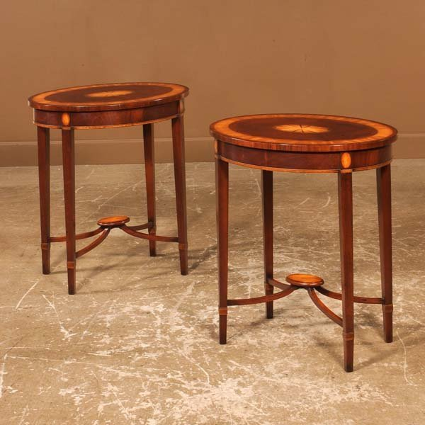 447: Pair of oval Sheraton style mahogany side tables w
