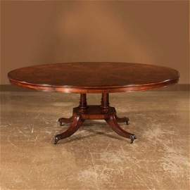 540: Regency style mahogany circular dining table with