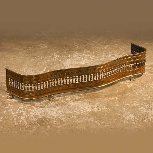 8: English pierced brass serpentine shaped fender on cl