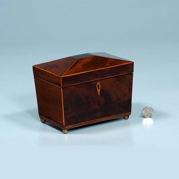 11: Inlaid Sheraton mahogany tea caddy with diamond sha