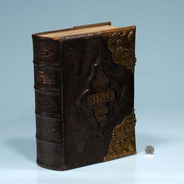 23: Embossed leather bound Bible with engraved brass mo