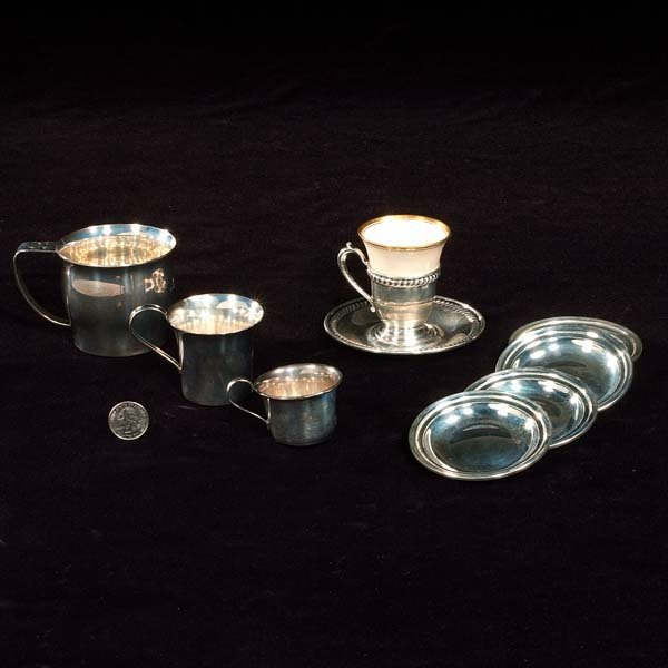 434: Sterling silver demitasse cup and saucer, four but