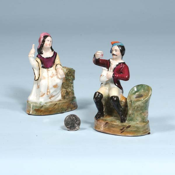 3: Pair of porcelain figures of a man and woman seated,