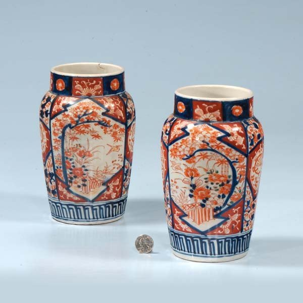 7: Pair of Imari porcelain vases with scenic bird and f