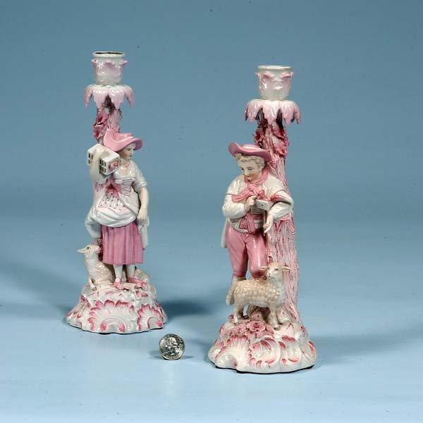 10: Pair of Augustus Rex porcelain candlesticks with fi
