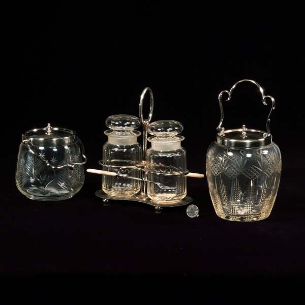 12: Two cut crystal biscuit jars with silver tops and a