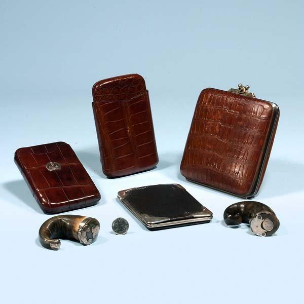 15: Two silver mounted snuff mulls, two crocodile cigar