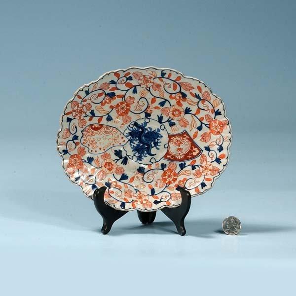23: Oval Imari porcelain dish with cobalt blue and bitt