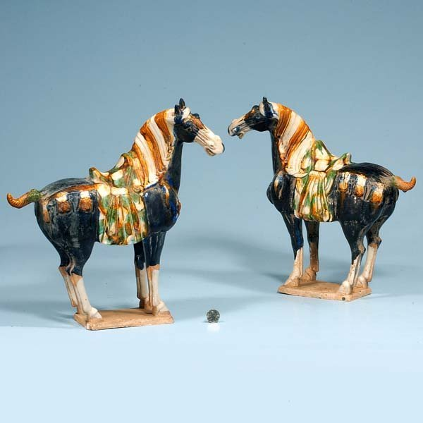 434: Pair of glazed terra cotta horses with saddles, 14
