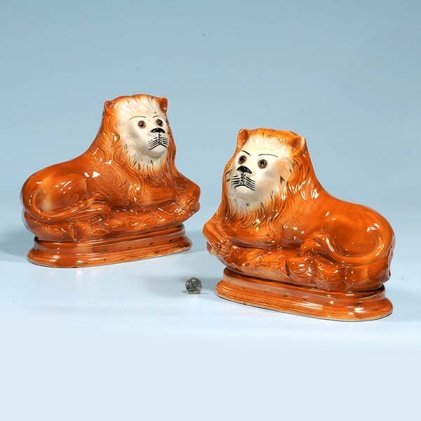 440: Large pair of reclining Staffordshire lions with g