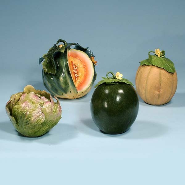 441: Group of four pieces of ceramic fruit by noted art