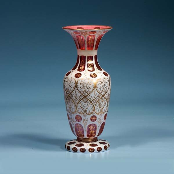 10: Overlay cranberry glass vase with gold gilt scroll