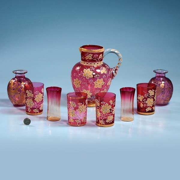 """20: Cranberry pitcher with floral decoration, 9"""" high,"""