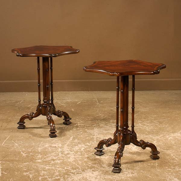21: Pair of Chippendale style mahogany tables on carved