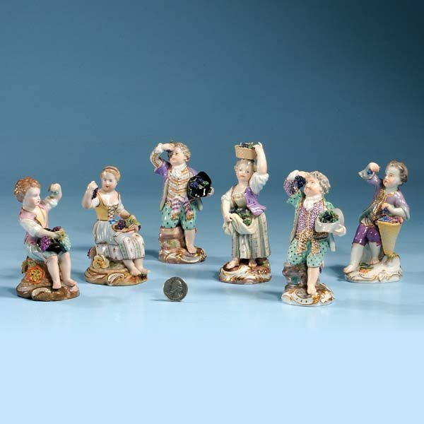 22: Group of six German porcelain figures with grapes,