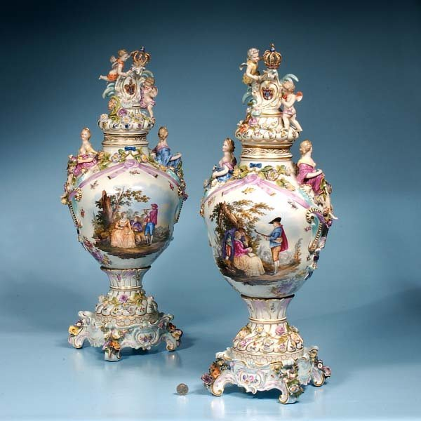 23: Pair of German porcelain vases with figural and flo