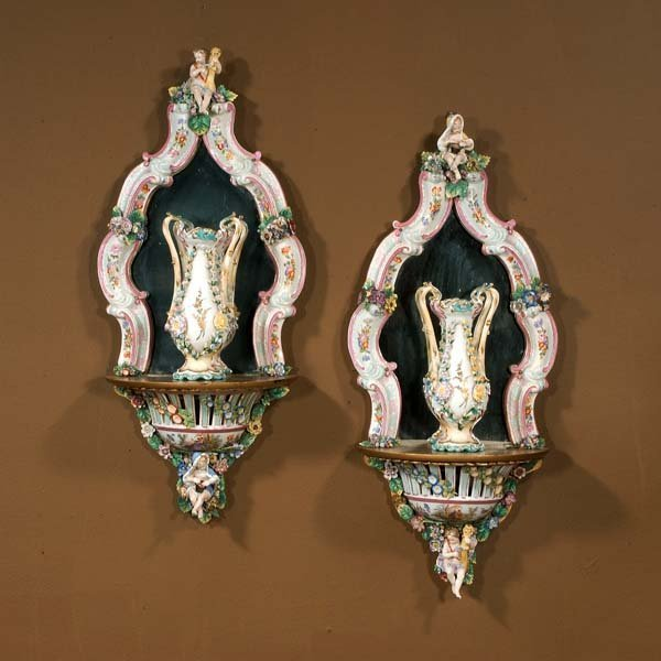 605: Pair of porcelain mirrored back wall brackets with