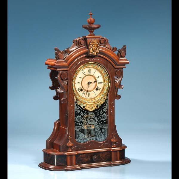 1018: American walnut Ansonia mantle clock with carved