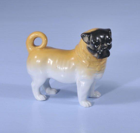 "9: Staffordshire figure of a pug, 7"" long, 6-1/2"" high"