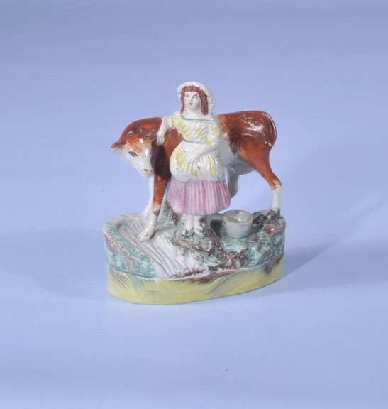 15: 19th century Staffordshire figure of a woman and a
