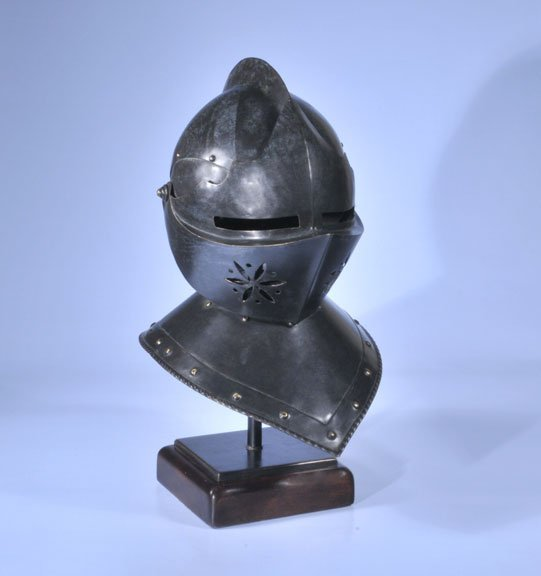 """22: Metal helmet mounted on a wooden stand, 22"""" high"""