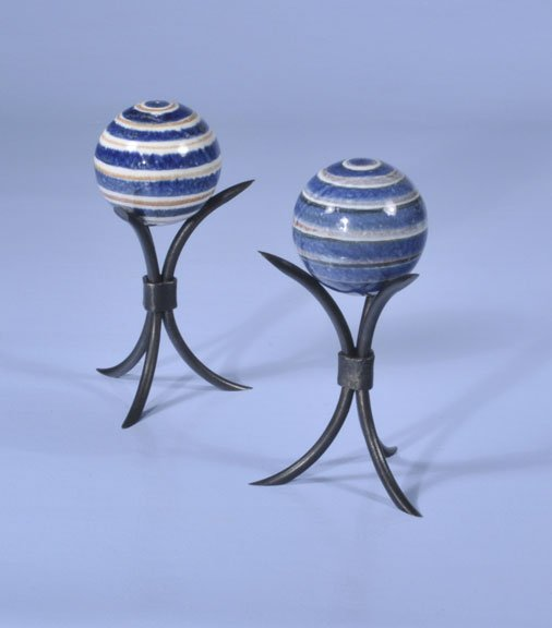 435: Two blue and white carpet balls with iron holders,