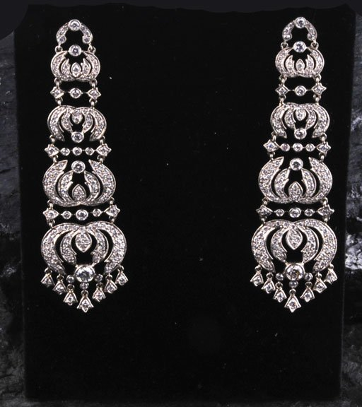 447: Pair of 18 kt. white gold ornate earrings with 312