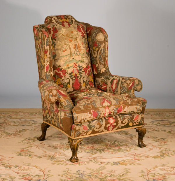 1077: Superb Queen Anne wing chair on four walnut cabri