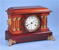 1349 American mahogany mantle clock with two halfcolu