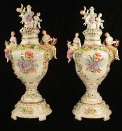 Pair of large German porcelain capped urns