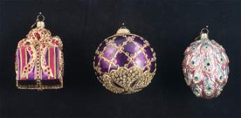 Group of three Jay Strongwater enamel ornaments