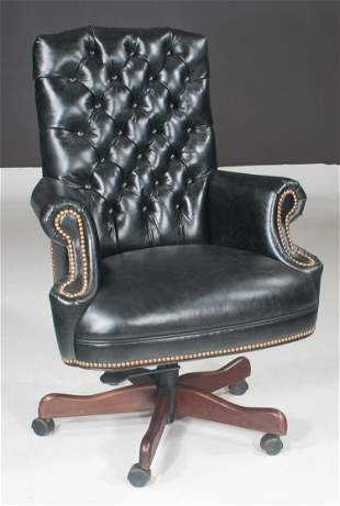 Office desk chair with black leather upholstery