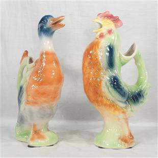 Pair of St. Clement, French water pitchers