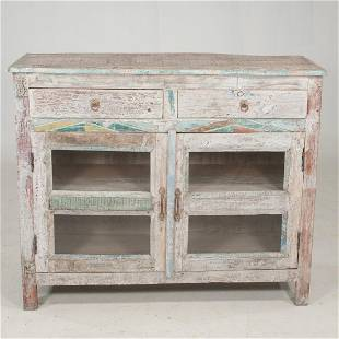 Rustic painted cupboard with geometric design