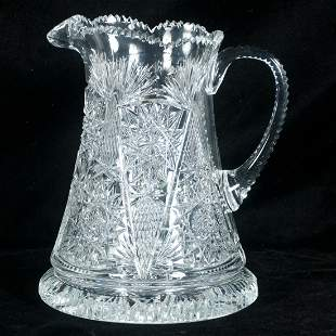 Cut crystal pitcher with shaped handle