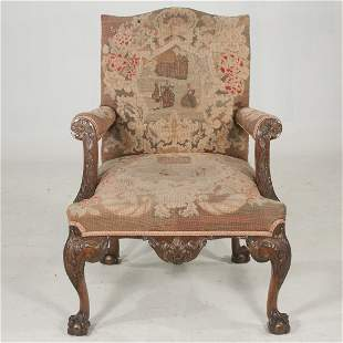 George II mahogany armchair with leaf carved arm