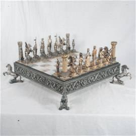 Guiseppe Vasari gilt metal chess set and board