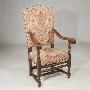 Italian walnut armchair with large scroll arms