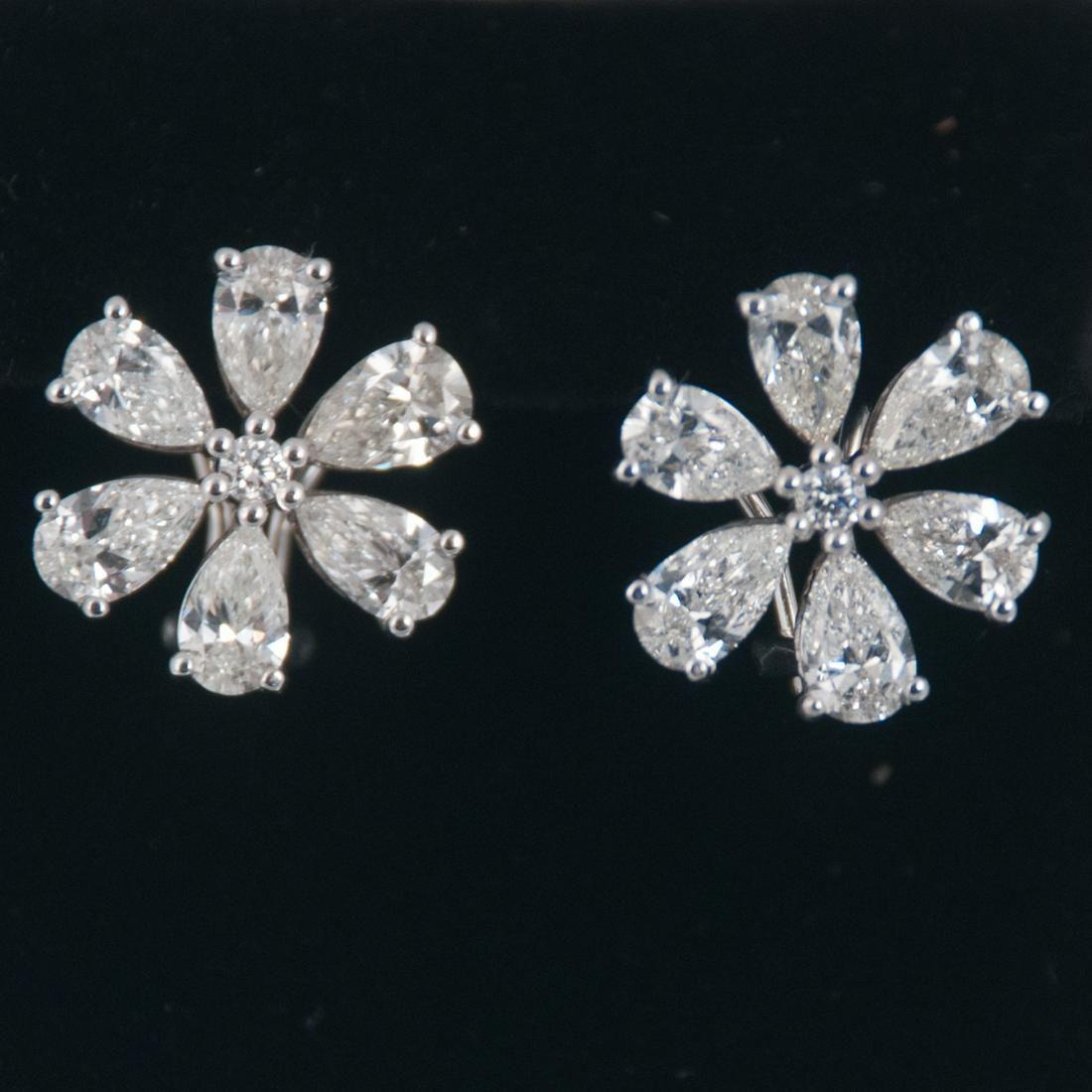 Pair of Cartier style 14K white gold diamond flower