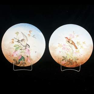 Pair of French porcelain chargers with multi color