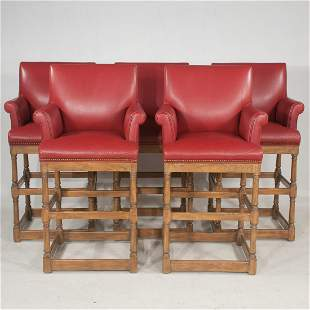 Group of five oak bar stools with red leather