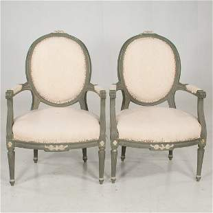 Pair of Louis XVI style painted fauteuils